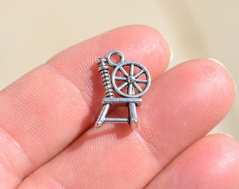 1 Silver Spinning Wheel Charm SC2509