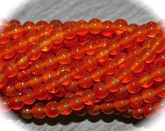 Orange carnelian beads 20 x 4 mm round