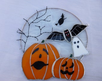 Swirly white moon with pumpkins, bat, witch, ghost. All ready for Halloween.