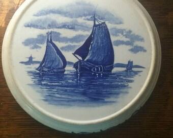 Antique German made blue sailing boats trivet.