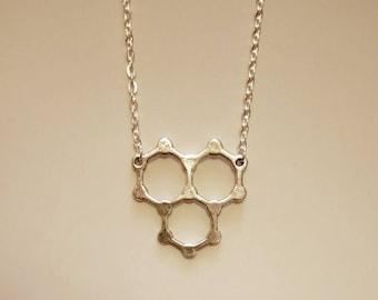 Water Molecule Necklace. Silver Plated. 21 Inch Approximate Length.