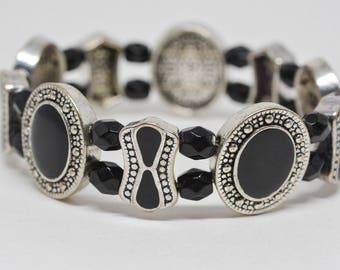 Lovely black and silver tone stretchable bracelet