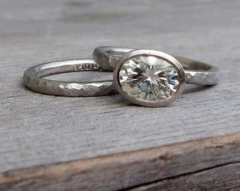 Moissanite Hammered Engagement Ring and Wedding Band - Oval Forever One G-H-I, in Recycled 950 Palladium with Peekaboo Bezel Setting