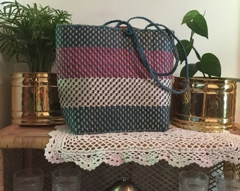 Pink blue and white vintage straw market or beach bag