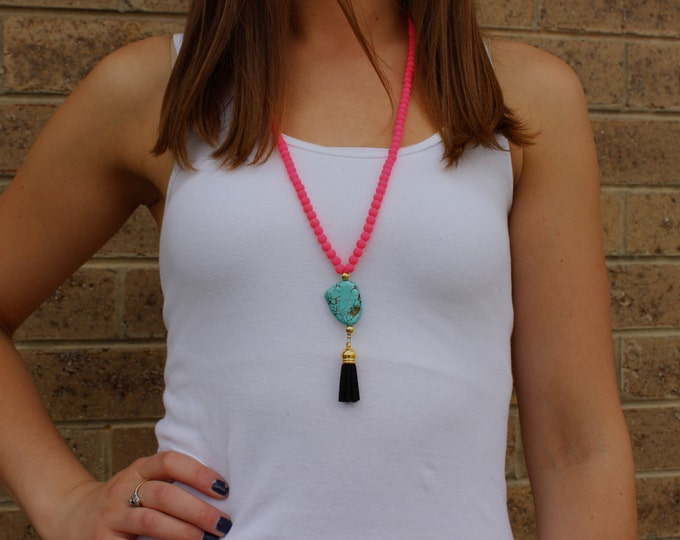 Neon Pink Beaded Statement Necklace with Turquoise Bead and Black Tassel.