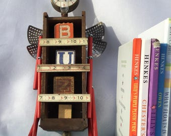 Demetrius- repurposed, vintage, game pieces, wall hanging, nursery decor, whimsical, bug, whimsical, assemblage, one of a kind