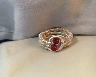 Fine silver wire wrapped ring with two garnet beads.
