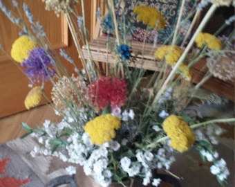 Floral arrangement of dyed dried flowers