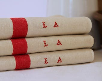 French linen teatowels mongrammed 'LA'