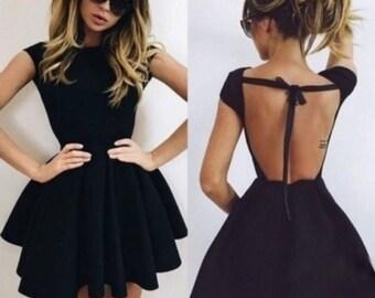 Black dress neckline behind