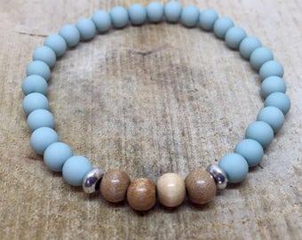 Spring bracelet in pastel blue with wood