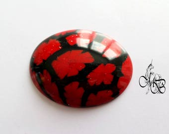 """Red and black"" polymer clay oval cabochon"