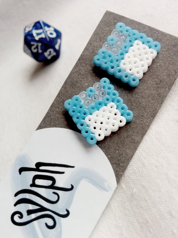 Light blue Geek IT floppy disk shaped stud earrings for geeks and gamer girls with retro style made out of Hama Mini Perler beads