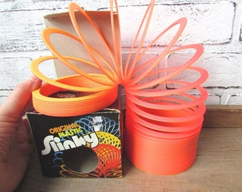 Plastic Slinky NOS Original Neon Orange and Pink Vintage 1980s Toy