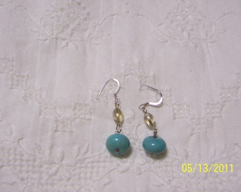 Turquoise Color Magnesite and crystal dangle earrings.