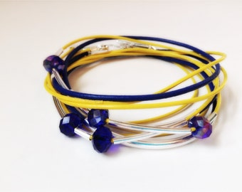 ATOMIC ISOTOPE Neon Yellow and cobalt Blue Leather wrap bracelet with silver tone tubes and cobalt Czech crystal beads