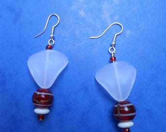 pair of earrings in red and white