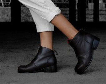 Zip boot is a simple ankle boot with a hand stitched sole and stacked leather heel.