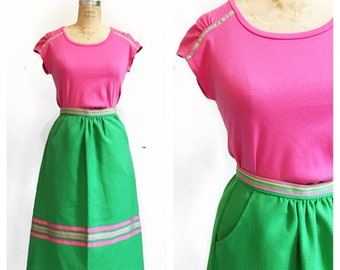 Cute bright green A line skirt set with pink trim and pockets and co-ordinating jersey top. Size XS/S.