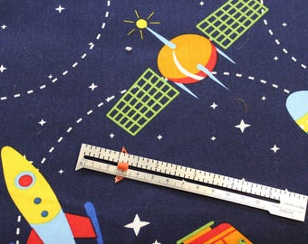 """Flying Rockets on navy 100% cotton fabric 42-44"""" wide"""