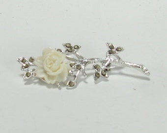 Broach of Soft White Lucite Rose Accented with Marcasite on Silver Stem