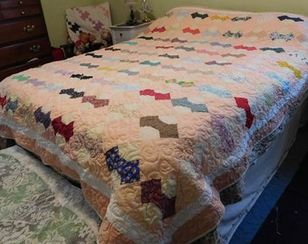 This beautiful quilt is called Bowties, it is a pieced quilt, machine quilted, colorful, handcrafted, unique,  Comforter, peach colored