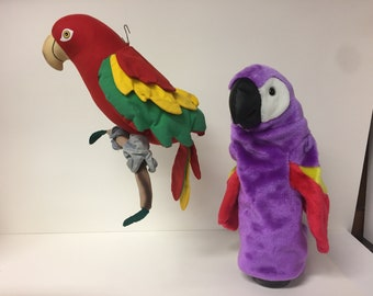 Toucan puppet and hanging parrot