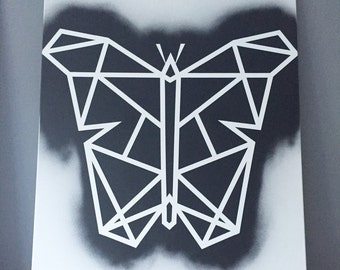 Geometric black and white butterfly on canvas