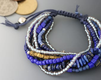 Multi-strand bracelet with macrame sliding knot. One size fits most. Lapis and sterling jewelry.