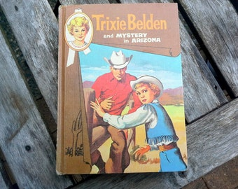 Trixie Beldon and Mystery in Arizona, by Julie Campbell, Illustrated by Mary Stevens, Whiteman publishing co, Racine, Wisconsin