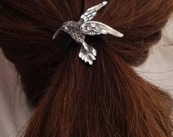 Small humming bird pony tail cover
