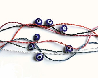 Silk bracelet with blue evil eye pendant in various colors