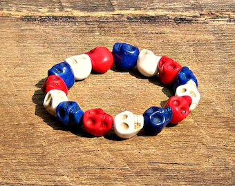 Skulls Red White Blue Bracelet helps provide service dogs to military veterans soldiers USA United States America patriotic rocker