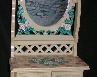Small cabinet with mirror decorated with painted flowers