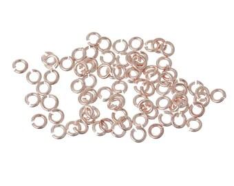 Pink x 50 3 mm gold metal rings.