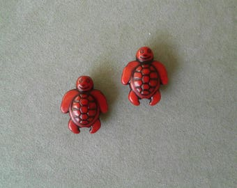 2 turtles acrylic red beads