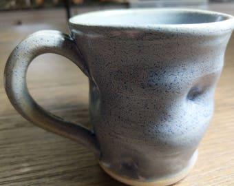 Blue handmade ceramic mug.