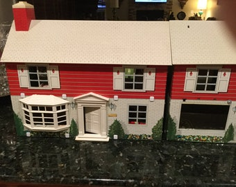 2 Vintage Marx 2 story colonial style tin doll houses from the  1960's with 74 Marx pieces of-furniure and 19 people.