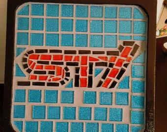 STI mosaic plaque