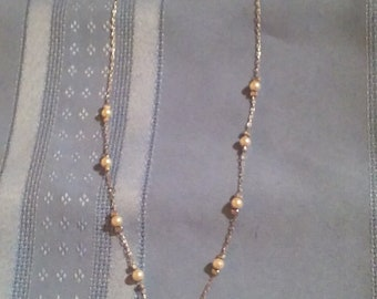 A Multi-Faux Pearl Silver Necklace With A Small Faux Pearl Pendant