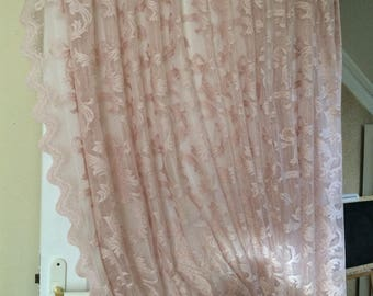 Old pink sheer lace curtains