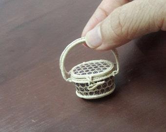 Tiny wicker basket by Pranee