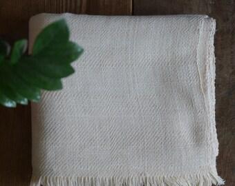 Khadi throw - hand-spun and handwoven khadi throw , khadi blanket .