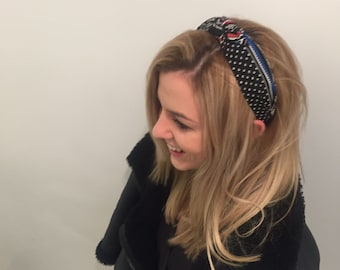 Hand made hair band with an adjustable bow