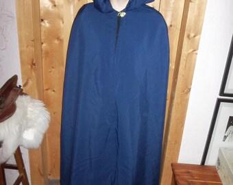A dark blue cloak with a gold leaf clasp