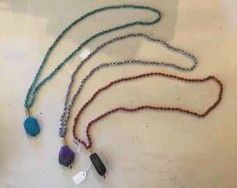 Long necklaces of natural stones with pendant