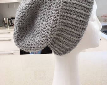 Cute crocheted slouch hat, beanie, in light grey super soft yarn.