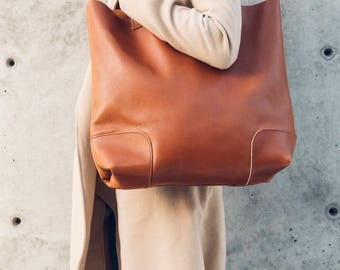 the weekender tote in cognac // large leather tote with thick handle straps