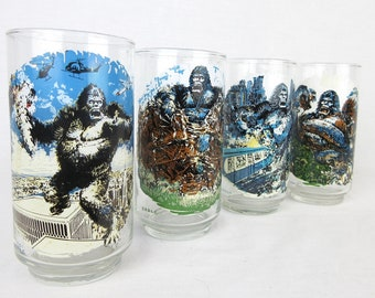 Vintage 1976 King Kong Collector Glasses / Set of Four / Serpent Battle, Twin Towers, Skull Island, NYC Subway / Cartoon / Coca Cola Promo