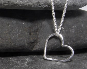 Floating heart pendant, with a lightly hammered texture in sterling silver - hand made in Cornwall